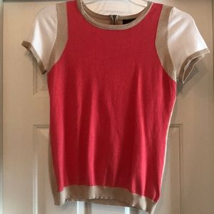 Coral, tan and white short sleeve sweater.